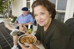 Senior Woman Having A Bowl Of Cereals Royalty Free Stock Images