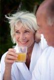 Senior woman having breakfast royalty free stock images