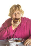 Senior woman is having breakfast Stock Photography