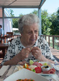 Senior woman having breakfast Royalty Free Stock Photo