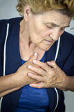 Senior woman having chest pain Stock Image