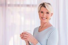 Senior woman having coffee Royalty Free Stock Image