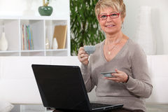 Senior woman having a coffee Stock Photography