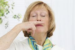 Senior woman having a cold Stock Image