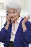 Senior woman having conversation  on mobile phone Stock Image