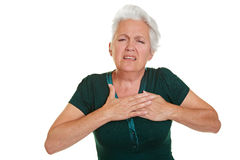 Senior woman having coronary. And holding hand to her chest Royalty Free Stock Photography