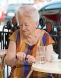 Senior woman having a cup of coffee Stock Photography
