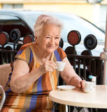 Senior woman having a cup of coffee Royalty Free Stock Images