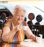 Senior woman having a cup of coffee Stock Image