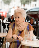 Senior woman having a cup of coffee Royalty Free Stock Image