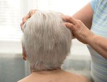Senior woman having facial massage Stock Images