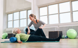 Senior woman having a friendly chat with her personal trainer Royalty Free Stock Image