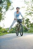 Senior woman having fun riding her bike Royalty Free Stock Image