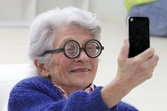 Senior woman having fun selfie herself Stock Photography