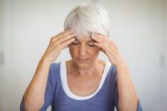 Senior woman having headache Royalty Free Stock Image