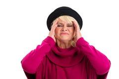 Senior woman having headache. Royalty Free Stock Photography