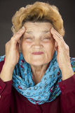 Senior woman having headache Stock Image