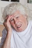 Senior Woman having Headache Royalty Free Stock Photos