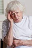 Senior Woman having Headache Stock Photo