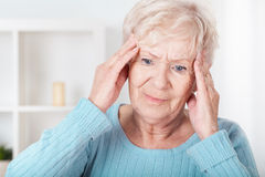 Senior woman having headache Stock Photo