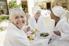 Senior Woman Having Healthy Food With Friends Royalty Free Stock Photo