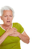 Senior woman having heart attack Stock Images