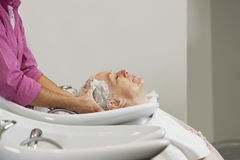 A senior woman having her hair shampooed at a hairdressing salon, close up Royalty Free Stock Photo