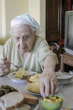 Senior woman having her lunch / supper at home Royalty Free Stock Image