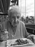 Senior woman having lunch Stock Photos