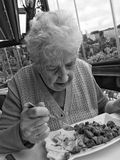 Senior woman having lunch Royalty Free Stock Images