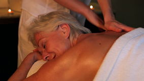 Senior Woman Having Massage In Spa. Senior woman relaxing with massage at beauty spa.Shot on Canon 5d Mk2 with a frame rate of 30fps stock footage