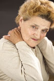 Senior woman having neck ache Stock Photos