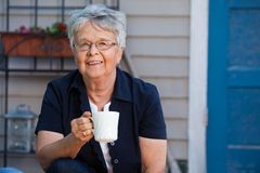 Senior woman having tea Stock Photos
