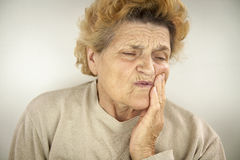 Senior woman having teeth ache. Portrait Royalty Free Stock Photos