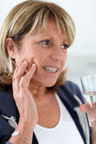 Senior woman having a toothache Royalty Free Stock Image