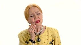 Senior woman having toothache. stock video