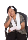 Senior woman with head and hand injury. Isolated on white background stock photos