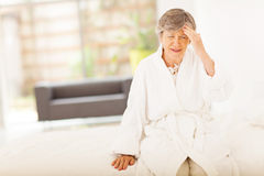Senior woman headache Stock Image