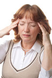 Senior woman with headache isolated Royalty Free Stock Image