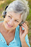 Senior woman with headphone Stock Photos