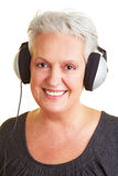 Senior woman with headphones Stock Photos