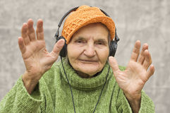 Senior woman with headphones listening to music. Royalty Free Stock Photo