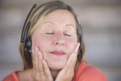 Senior woman with headphones music listening Stock Image