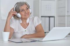 Senior woman with headphones Royalty Free Stock Image