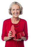 Senior woman with heart shaped gift box Royalty Free Stock Image