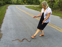 Senior Woman - Helps Snake Stock Photography