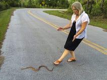 Senior Woman - Helps Snake Stock Photography