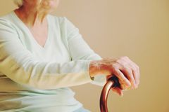 Elderly woman with walking stick at home royalty free stock photo