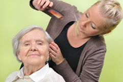 Senior woman with her caregiver. Royalty Free Stock Images
