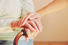 Senior woman with her caregiver at home. Concept senior people health care. Close up hands old lady and her nurse. Concept senior people health care Royalty Free Stock Images